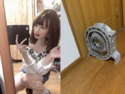 Trying on women's clothing, she uses rotary housing to block door