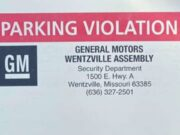 Tesla gets GM parking ticket for being foreign